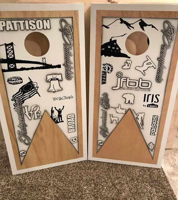 Custom painted personalized cornhole boards.