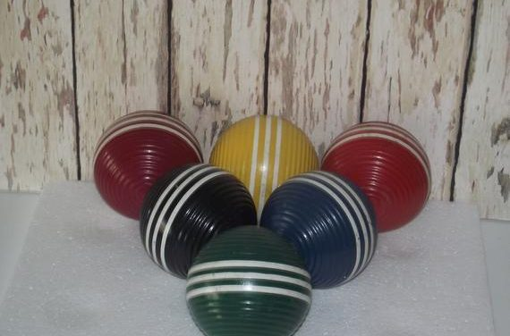 "Six vintage,colorful, striped & heavy croquet orbs (balls) mildly used, groved and 3 1/4"" in diameter, and in very good condition."